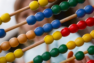 abacus with student image behind
