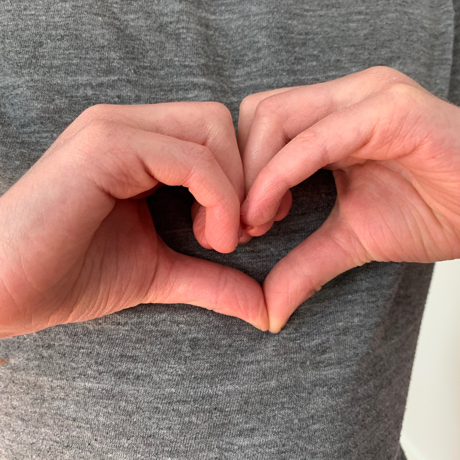 2 hands in the shape of a heart